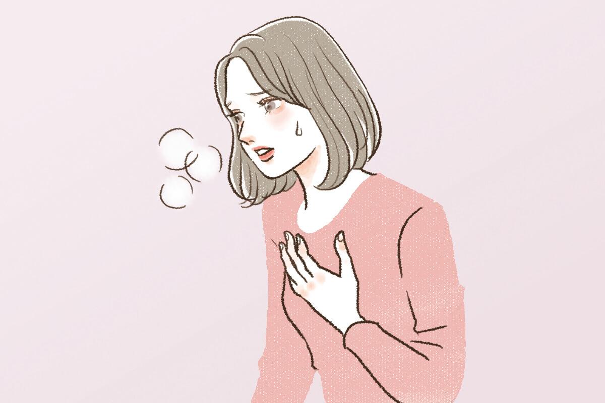 動悸・息切れをしている女性